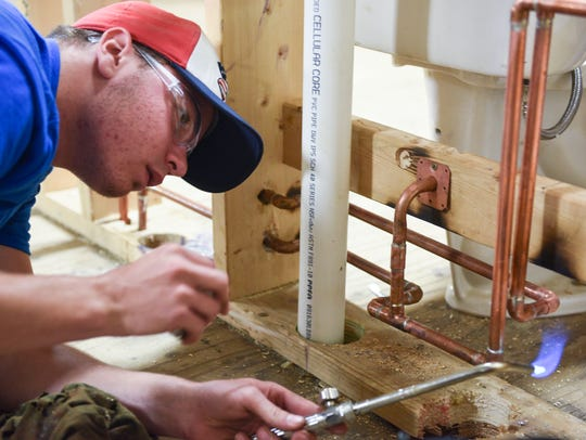 Nathan John, 19, a student in the plumbing program