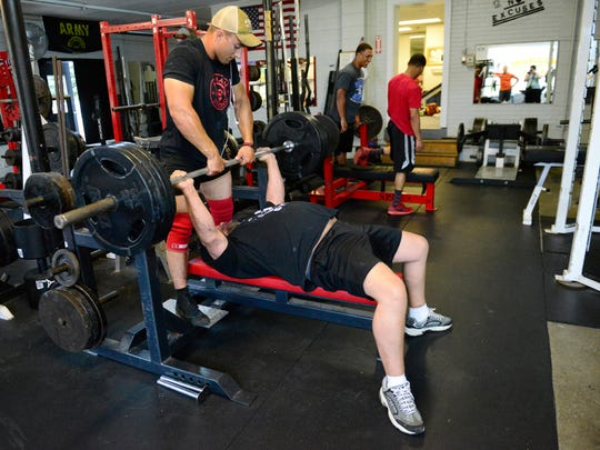 Brian Brammer works out on a bench press at Fremont's