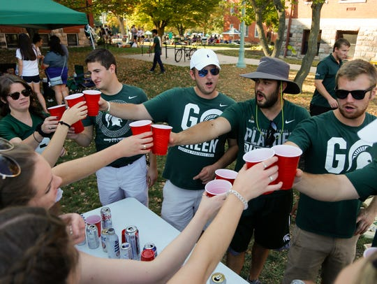 Michigan State University fans tailgate Saturday afternoon,