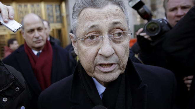 New York State Assembly Speaker Sheldon Silver is surrounded by media as he leaves a federal courthouse in New York, Thursday. Silver, 70, was arrested Thursday on public corruption charges and accused of using his position to obtain millions of dollars in bribes and kickbacks masked as legitimate income. A magistrate judge in federal court in Manhattan later released the lawmaker on $200,000 bail.