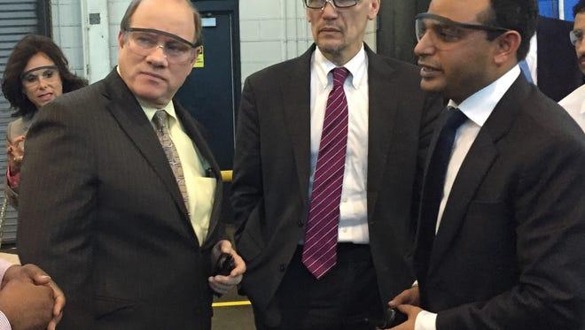 Sakthi Automotive CEO Lalit Verma, right, talks with Detroit Mayor Mike Duggan and U.S. Labor Secretary Thomas Perez on tour of Sakthi Detroit plant April 15, 2015.