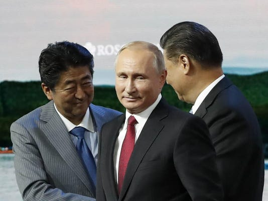 Vladimir Putin,Shinzo Abe,Xi Jinping