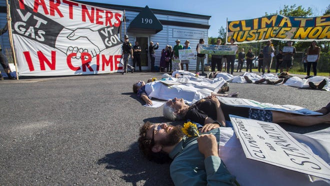 Protesters stage a die-in before the Public Service Board considers a Vermont Gas proposal for an easement to construct a natural gas pipeline through Geprags Community Park in Hinesburg during a hearing in Berlin on Thursday, August 4, 2016.