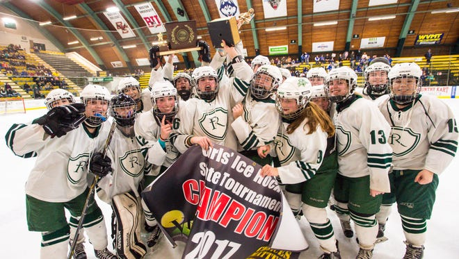 Rice Memorial players celebrate their victory over Missisquoi Valley Union in the DII girls hockey state championships in Burlington on Wednesday, March 8, 2017.