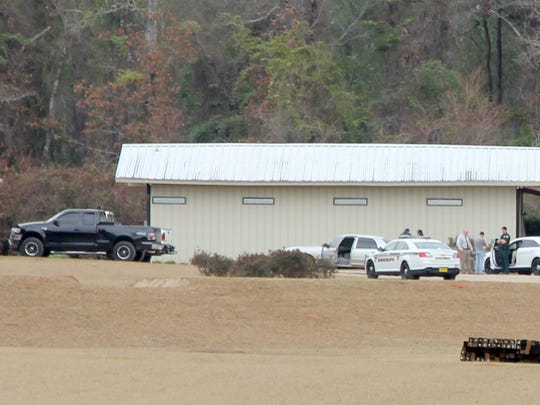 Investigators search Lively Technical Center Principal Woody Hildebrandt's property on U.S. Highway 90 east on Friday, Dec. 19.