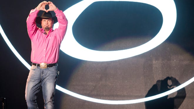 Garth Brooks greets the crowd during a free concert at the Ascend Amphitheater, Monday, Oct. 24, 2016, in Nashville, Tenn.