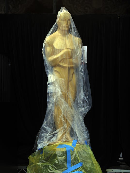 An Oscar is protected by a plastic bag o