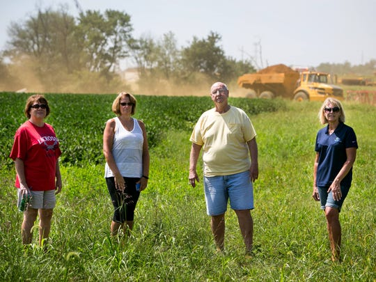 From left, Kaye Snook, Lisa Stanley, Robert Schultz and Patti Pecht all live in the Spring Arbor community next to the U.S. 301 construction in Middletown. They say more can be done to keep the dirt from the construction site away from area homes.