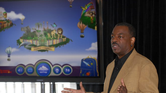 """FILE- This June 19, 2012 file photo shows LeVar Burton introducing the all new Reading Rainbow adventure app to the media, publishers and parents at the """"Reading Rainbow Relaunch"""" event in New York.  Burton's campaign to bring """"Reading Rainbow"""" to the online masses is off to an impressive start. It reached its fundraising goal within hours of its launch on Wednesday, May 28, 2014, on Kickstarter, according to the fundraising website. (AP Photo/Reading Rainbow, file)"""