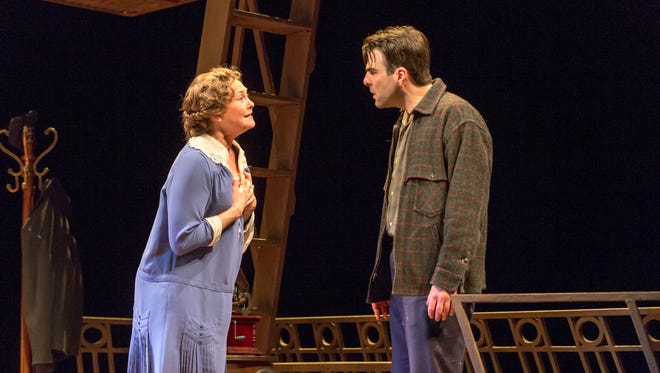 "This theater image released by Jeffrey Richards Associates shows Cherry Jones, left, and Zachary Quinto during a performance of ""The Glass Menagerie."" The production opens on Sept. 26, 2013 at the Booth Theatre in New York."