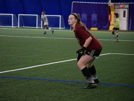 Hailey Lindow works on her goalkeeping stance during