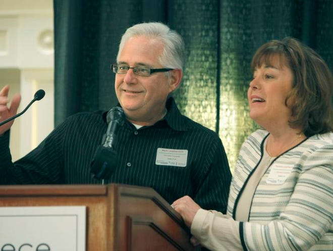Microenterprise winners  Mark and Pamela Leathersich, owners of Christie Carpets on Dewey Avenue, speak at   the Greece Chamber of Commerce's annual Small Business Awards luncheon   Friday.