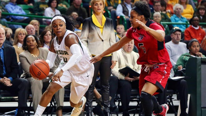 Baylor Bears guard Odyssey Sims  drives to the basket past Texas Tech Lady Raiders guard Diamond Lockhart during the second half at the Ferrell Center.