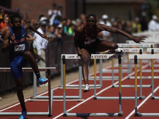 FSU's Tye Dickens, a former state champion hurdler at Godby, competes in the 110-meter high hurdles at the FSU Relays.