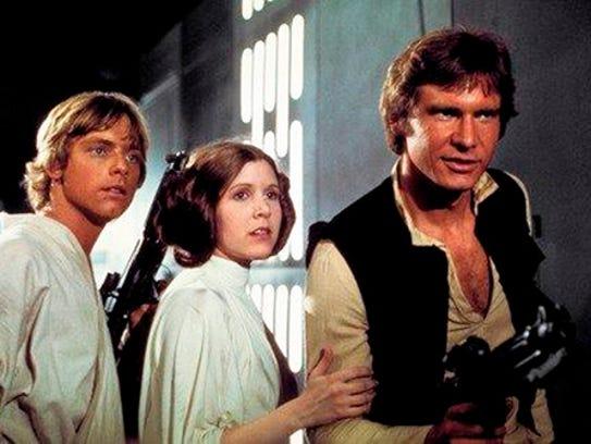 Mark Hamill, from left, as Luke Skywalker, Carrie Fisher