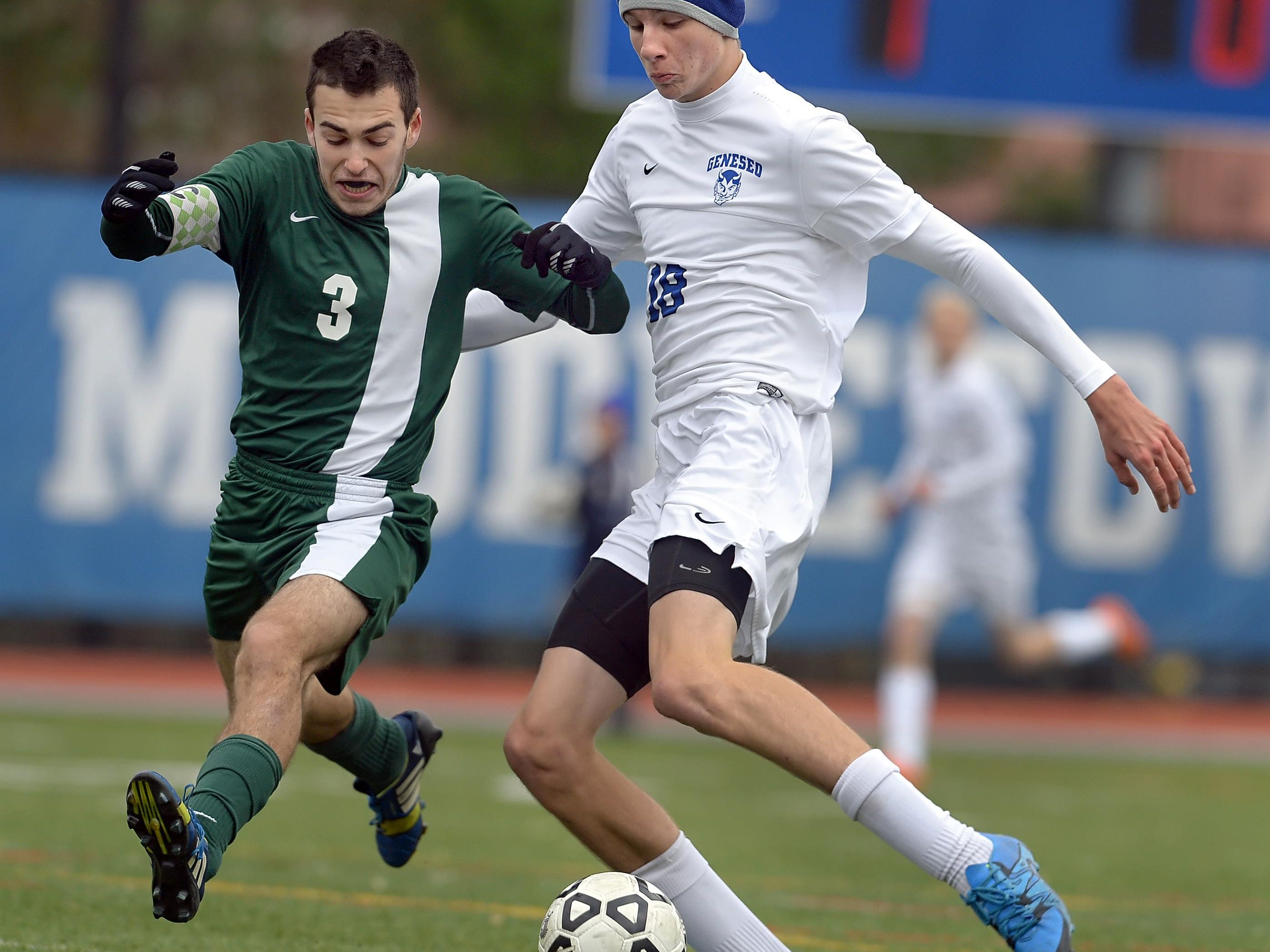 Geneseo's Kyle Rollins, right, takes a shot on goal while defended by Schecter's Ben Goldberg during a NYSPHSAA Boys Soccer Championships Class C semifinal played at Middletown High School on Saturday, November 14, 2015. Geneseo's season ends with a 1-0 loss to Schecter-I.