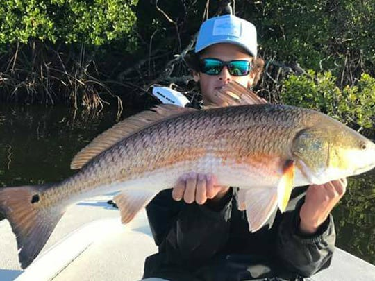 Hunter Smith of Stuart with his winning redfish in the Courage On All Fronts fishing tournament.