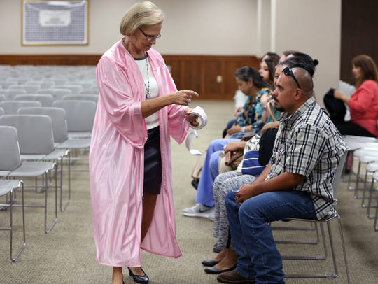 117th District Court Judge Sandra Watts hands out stickers