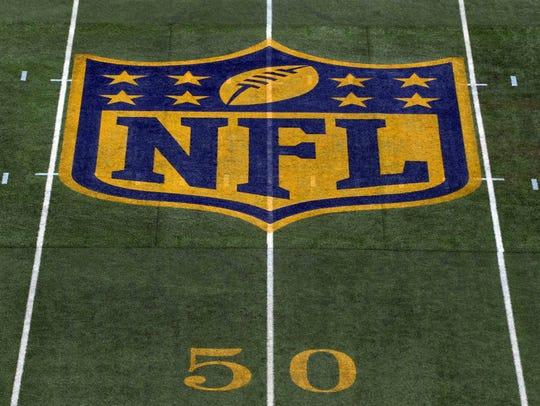 he NFL gold shield logo.