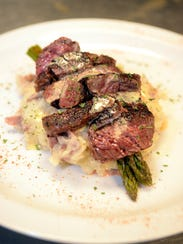 The Crescent City Bistro's Steak Oscar is served with