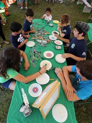 FInal day for the 2016 Somerset County 4-H Fair is photographed on Friday  August 12, 2016. The 4-H Robotics Club held a robot spin art event at their tent. People has the change to make spin art on a paper plate while the robot spins the plate.