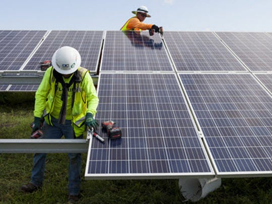 Construction workers installing panels at Florida Power