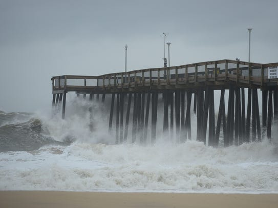 Waves roll under the Ocean City Fishing Pier on Tuesday,