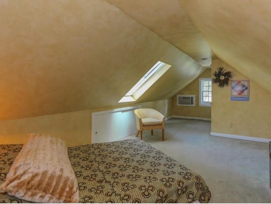 The finished attic can be lived in or used for storage.