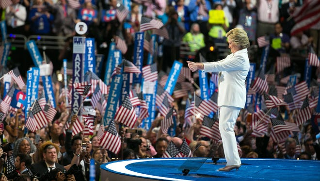 Hillary Clinton gives two thumbs up to the crowd as she gets a standing ovation at the DNC as she accepts her nomination on the final day of the Democratic National Convention at the Wells Fargo Center in Philadelphia.