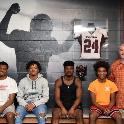 Fulton High senior football players Reg'Onte Jones,