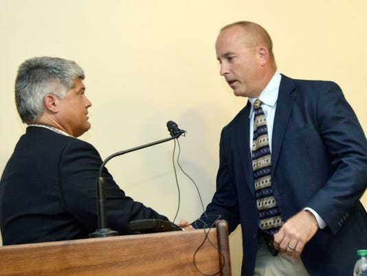 Alexandria mayor Jacques Roy (left) shakes hand with Jarrod King as the new Alexandria Police Department police chief on Wednesday, April 30, 2018.