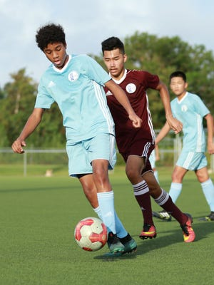Guam Under-15 national team player Nainoa Norton controls the ball as he makes his way through the midfield during a recent training match against the Guam Under-17 national team training squad at the Guam Football Association National Training Center.