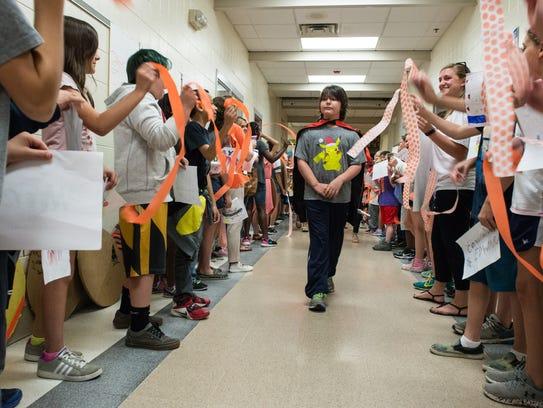 Students line the hall of Westside Intermediate School