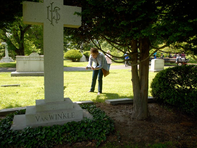 Carla Carlton takes a photo of Julian Proctor Van Winkle's grave of the Pappy Van Winkle distillery on the ÒA Journey through Bourbon History at Cave Hill CemeteryÓ tour.  May 18, 2014