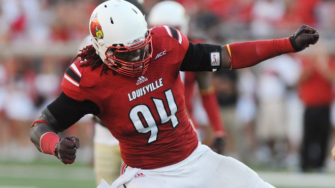 U of L's Lorenzo Mauldin (94) celebrates a sack during the Cards' game against Wake Forest this season.