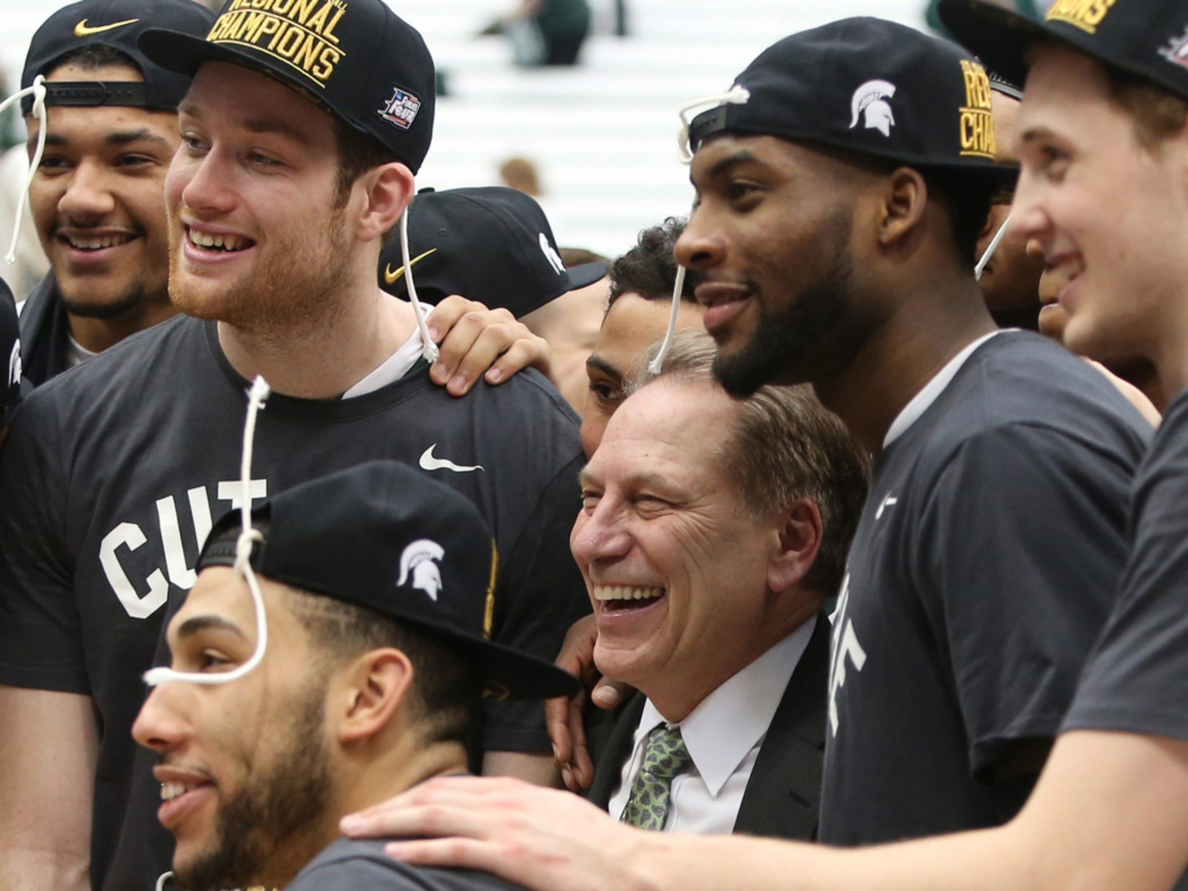 Michigan State head coach Tom Izzo and his players