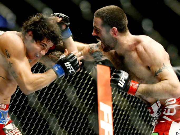 Xenia, Ohio native Matt Brown (red gloves) fights Erick Silva (blue gloves) during a welterweight bout at US Bank Arena. Brown won by TKO in the third round.