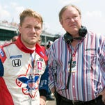 Dale Coyne, right, talks with driver James Jakes during qualifying for the 2012 Indianapolis 500.