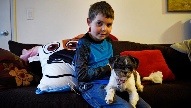 Joe Maldonado, a transgender boy who was kicked out of the Cub Scouts because he was born a girl, with his dog Oreo at his home on Tuesday.