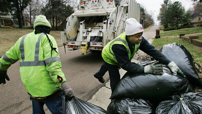 (Thu 23 Mar 06) Photo by A.J. Wolfe.  Brandon Jackson, left, and Ray Joyce pick up trash on Windy Oaks Drive in Germantown.