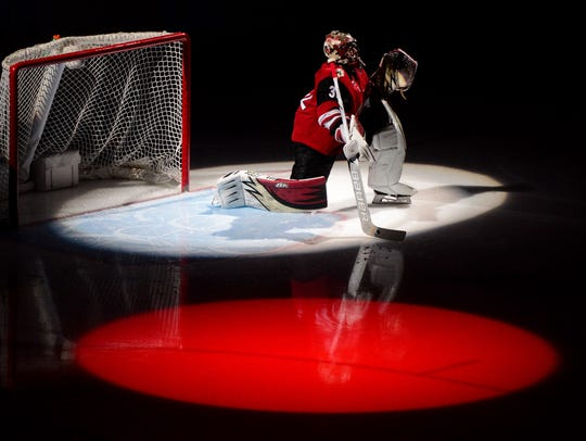 Coyotes goaltender Antti Raanta looks on prior to a game against the Blackhawks on Feb. 12 at Gila River Arena.
