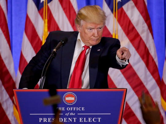 President-elect Donald Trump takes questions during