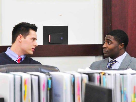 Defendants Brandon Vandenburg and Cory Batey talk during