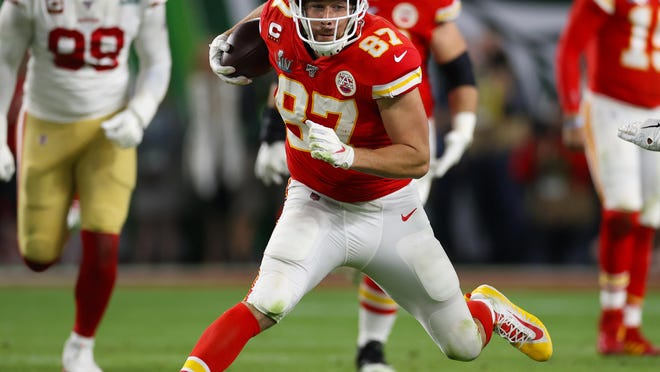Kansas City Chiefs tight end Travis Kelce (87) runs after a reception against the San Francisco 49ers during Super Bowl 54 at Hard Rock Stadium in Miami Gardens, Fla.