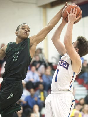 Winslow Township's Sidney Brown, left, blocks a shot by Washington Township's Colin Meintel during the third quarter during Tuesday's game.