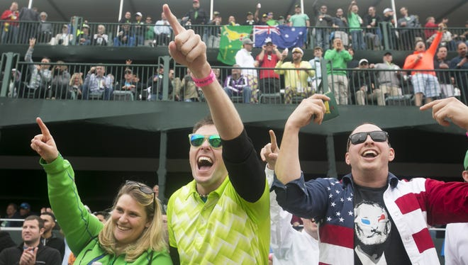 Golf fans (from left) Spring Offenbacher of Minneapolis, her husband, Charlie Offenbacher and Simeon Klopper of Midland, Tex., cheer during golf action at the Waste Management Phoenix Open at TPC Scottsdale on Jan 31.