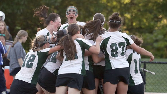 Brewster celebrates after defeating Hendrick Hudson 17-9 in the Section 1 Class C girls lacrosse championship at the Torne Valley Athletic Center in Hillburn May 24, 2018.