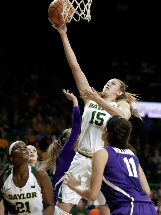 FILE- In this Jan. 20, 2018, file photo, Baylor's Kalani Brown (21) watches as forward Lauren Cox (15) goes up for a shot over Kansas State's Peyton Williams (11) during the second half of an NCAA college basketball game Waco, Texas. Baylor opens NCAA Tournament play at home for the sixth year in a row. The Lady Bears have arguably the best inside duo in the nation, with 6-7 Big 12 Player of the Year Kalani Brown and 6-4 Lauren Cox. Their guards are pretty good too. (AP Photo/Tony Gutierrez, File)
