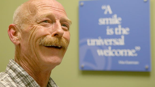 """Retired Army Sgt. Michael Lowe smiles as he talks about his experience, saying """"Aspen Dental has been very good to me."""""""