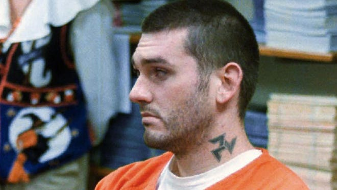In this Oct. 31 1997, file photo, Daniel Lewis Lee waits for his arraignment hearing for murder in the Pope County Detention Center in Russellville, Ark. On Tuesday, July 7, 2020, family members of the victims of Lee, who is scheduled to be put to death next week, asked a federal judge to delay his execution, saying the coronavirus pandemic puts them at risk if they travel to attend it.
